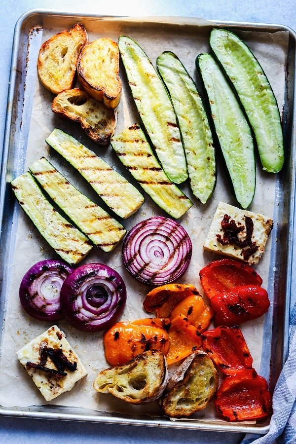 vegetables, bread and feta charred on sheet pan