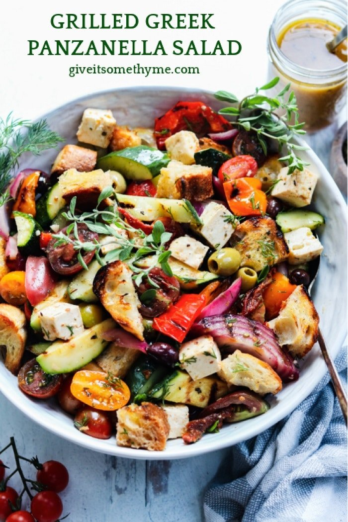 Grilled Greek Panzanella Salad   giveitsomethyme.com – an easy and delicious farmers market inspired salad featuring seasonal veggies, crusty bread and feta cheese coated in a tangy red wine vinaigrette.