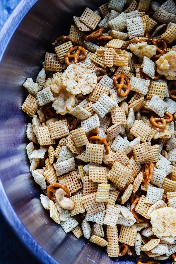 chex cereal, pretzels, cashews, and parmesan crisps in large bowl