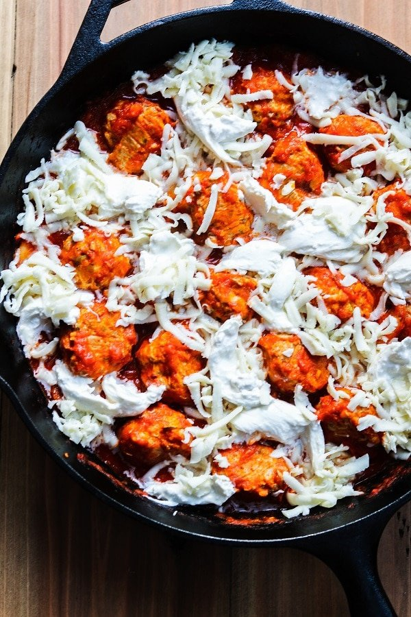 cheese evenly distributed over meatballs and sauce in skillet