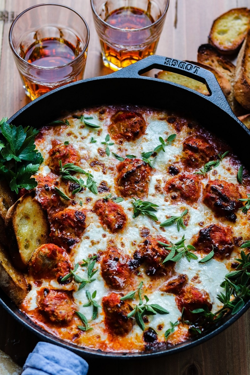 Cheesy Turkey Meatball Skillet served straight from cast iron skillet with crusty bread.