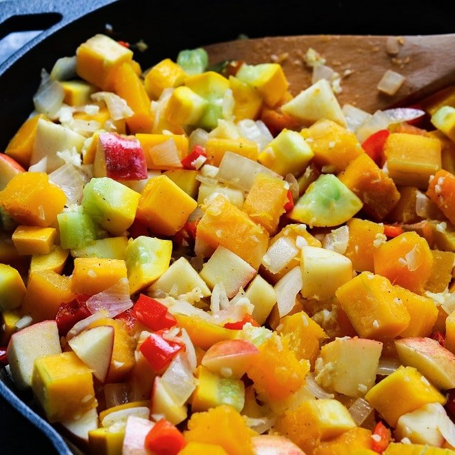 vegetables and sauce cooking in skillet