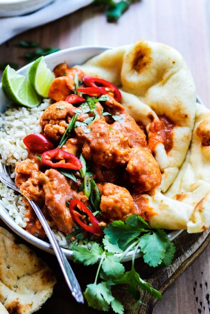 Slow Cooker Butter Chicken and Cauliflower | giveitsomethyme.com – An Indian classic so rich, creamy and healthy using coconut milk and super flavorful spices. #butterchicken #butterchickendairyfree #slowcookerbutterchicken #slowcookerbutterchickencoconutmilk #butterchickencrockpot #indianfoodrecipes #dairyfreedinner #chickendinnerideas #giveitsomethyme