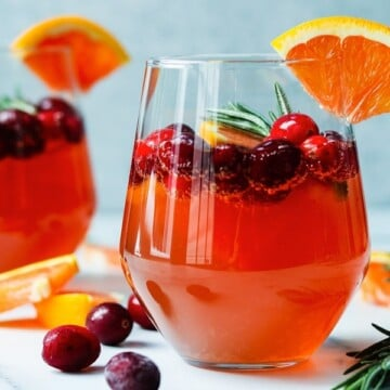 Cranberry Orange Prosecco Cocktail | giveitsomethyme.com - This crisp and refreshing cocktail is festive, delicious and perfect for celebrating holidays throughout the year.