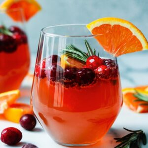 Cranberry Orange Prosecco Cocktail   giveitsomethyme.com - This crisp and refreshing cocktail is festive, delicious and perfect for celebrating holidays throughout the year.