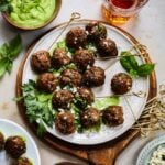 Greek Lamb Meatballs with Creamy Green Herb Sauce   giveitsomethyme.com – These make-ahead meatballs are loaded with garlic, smoked paprika, cumin and oregano for a super flavorful bite. A pinch of red pepper gives them just the right kick that pairs perfectly with the creamy, herby dip! #meatballs #lambmeatballs #lambmeatballsgreek #lambmeatballsbaked #greeklambrecipes #mediterraneanrecipes #appetizers #giveitsomethyme