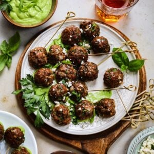 Greek Lamb Meatballs with Creamy Green Herb Sauce | giveitsomethyme.com – These make-ahead meatballs are loaded with garlic, smoked paprika, cumin and oregano for a super flavorful bite. A pinch of red pepper gives them just the right kick that pairs perfectly with the creamy, herby dip!