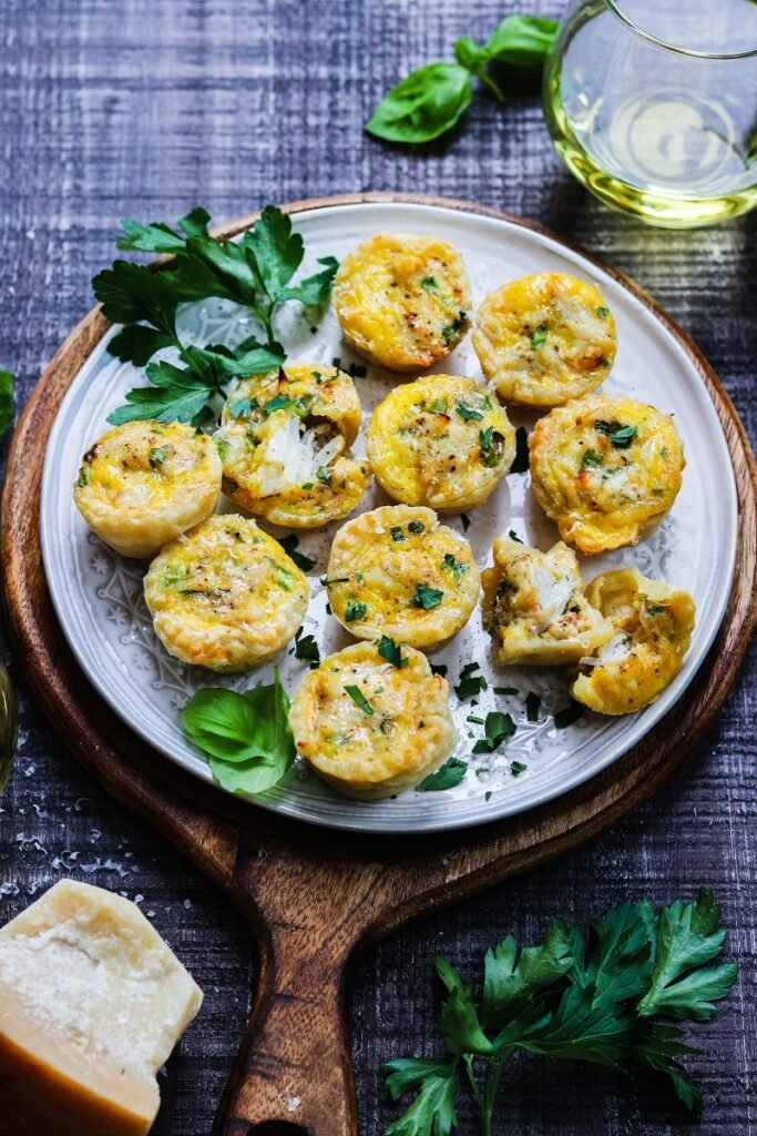 Mini Crab Puff Pastry Quiches | giveitsomethyme.com – Cheesy bitesize mini quiches loaded with jumbo lump crabmeat and so easy to make. A perfect make-ahead appetizer throughout the year! #appetizers #crabappetizer #crabrecipes #jumbolumpcrabrecipes #crabminiquiches #puffpastryappetizers #holidayappetizers #miniquichesinmuffintin #giveitsomethyme