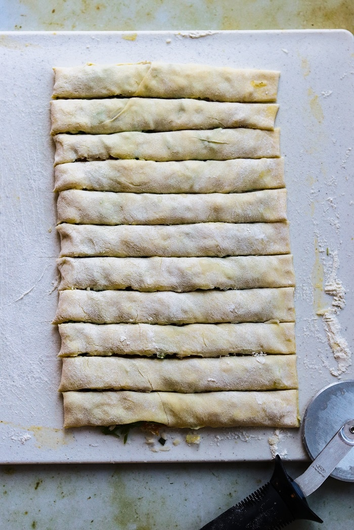 puff pastry filled, folded and cut into strips