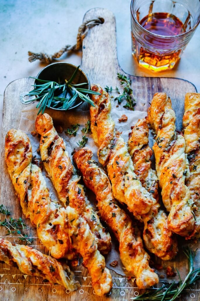 Cheesy Prosciutto Puff Pastry Twists | giveitsomethyme.com – Delicious, light and flaky puff pastry twisted with fontina, prosciutto, Dijon mustard and rosemary. Perfect for game day and holiday snacking! #puffpastry #puffpastryappetizers #appetizers #cheesyappetizers #prosciuttorecipes #gamedayfood #holidayappetizers #giveitsomethyme