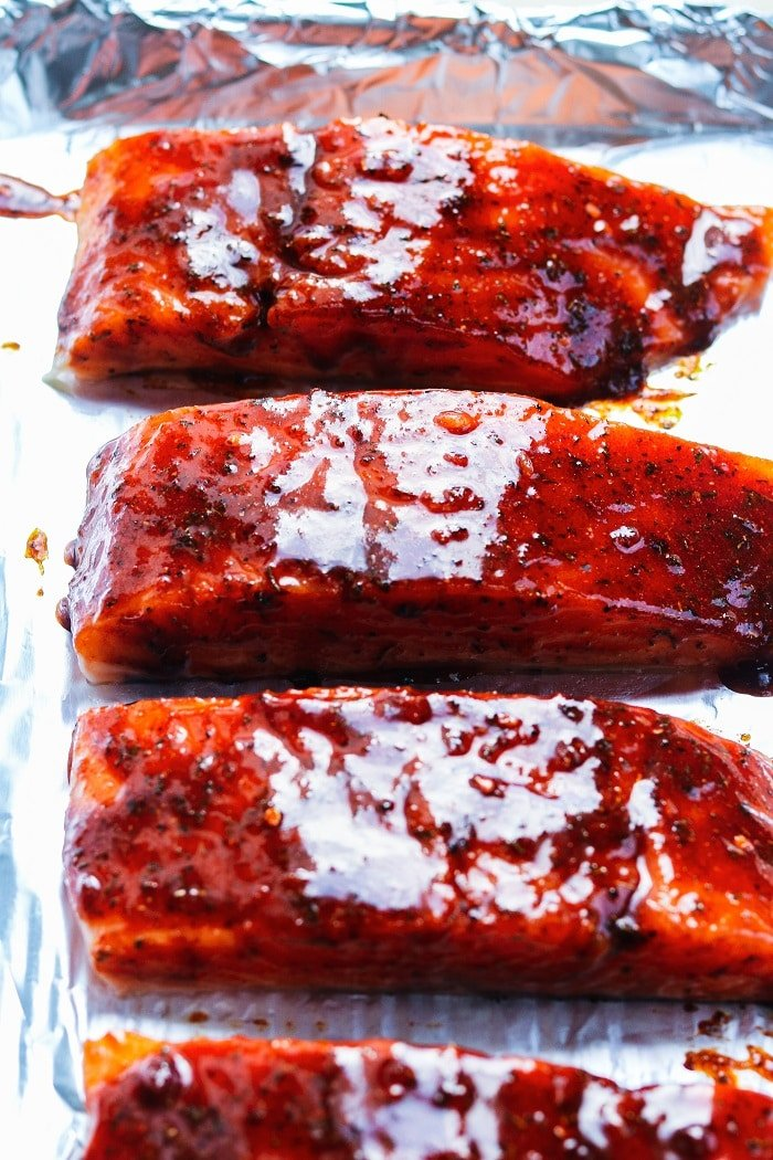 salmon slathered in jerk-spiced glaze ready to roast