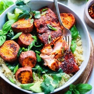 Jerk Salmon Quinoa Bowls w/ Sweet Potatoes & Spinach   giveitsomethyme.com – Fresh salmon fillets slathered in a jerk-spiced glaze along with roasted sweet potatoes and spinach over quinoa is a quick, easy and healthy dinner perfect for any night of the week!