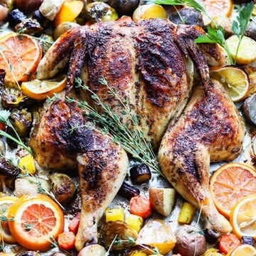 Sheet Pan Citrus Butter Spatchcock Chicken and Potatoes | giveitsomethyme.com – Delicious, tender and juicy chicken with crispy potatoes, Brussel sprouts and carrots round out this easy sheet pan meal perfect for any night of the week.
