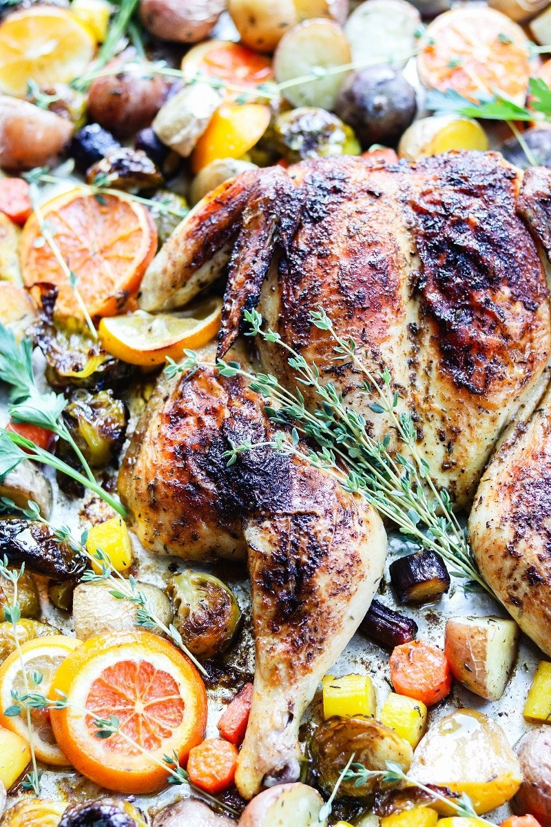 Sheet Pan Citrus Butter Spatchcock Chicken and Potatoes | giveitsomethyme.com – Delicious, tender and juicy chicken with crispy potatoes, Brussel sprouts and carrots round out this easy sheet pan meal perfect for any night of the week. #spatchcockchicken #butterfliedchicken #sheetpandinners #chickendinnerrecipes #chickenandpotatoes #glutenfreedinner #quickandeasydinners #giveitsomethyme