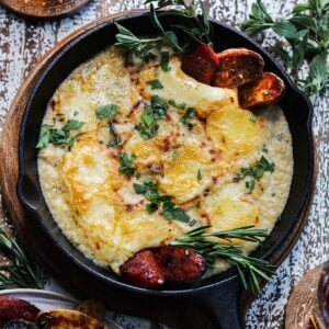 Cheesy Caramelized French Onion Dip | giveitsomethyme.com - This amazing no-mayo-or-sour-cream caramelized onion dip is blended with brie, cream cheese, yogurt and spices and served with roasted fingerling potatoes and chorizo!