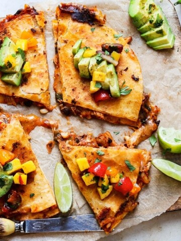 Crockpot Adobo Chicken Quesadillas | giveitsomethyme.com – Tender, juicy and perfectly spiced shredded chicken sandwiched between gooey cheese in crispy tortillas and topped with fresh Mango Salsa!