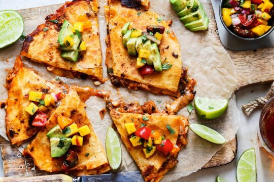 Crockpot Adobo Chicken Quesadillas | giveitsomethyme.com – Tender, juicy and perfectly spiced shredded chicken sandwiched between gooey cheese in crispy tortillas and topped with fresh Mango Salsa! #quesadillas #chickenquesadillas #chickenquesadillascrockpot #crockpotchickenrecipes #slowcookerchicken #mexicanfood #cincodemayopartyfood #cincodemayo #giveitsomethyme