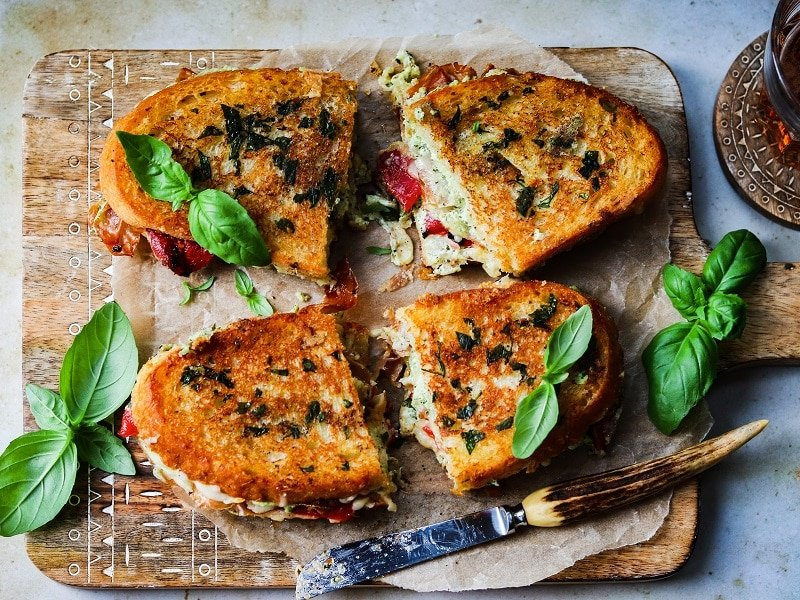 Italian Grilled Cheese w/ Pesto Whipped Ricotta & Herb Butter | giveitsomethyme.com – Layers of flavor abound in this four-cheese grilled cheese taking one of our favorite guilty pleasures to a whole new level. #grilledcheese #grilledcheesesandwich #italiangrilledcheese #comfortfood #grownupgrilledcheese #guiltypleasurefood #giveitsomethyme