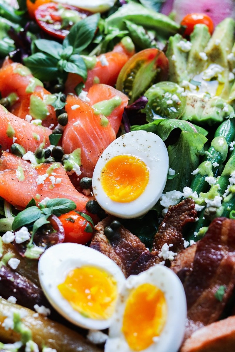 Spring Brunch Cobb Salad | giveitsomethyme.com - Loaded with fresh greens and veggies, smoked salmon, crispy bacon, soft-boiled eggs, feta, avocado and tomatoes, served with toasted baguette and a tangy, herb dressing. #cobbsalad #salad #springsalad #eastersalad #brunch #mothersdaybrunch #smokedsalmon #softboiledeggs #giveitsomethyme