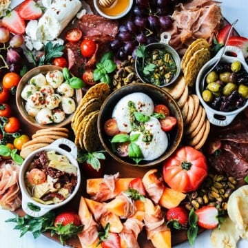 Weekend Snacking Charcuterie Board served on table | giveitsomethyme.com