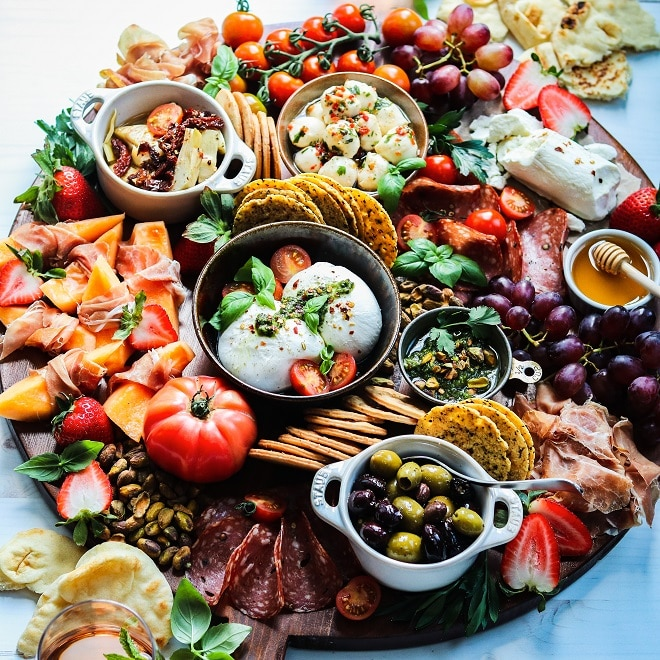Weekend Snacking Charcuterie Board | giveitsomethyme.com – Relax and enjoy this seasonal snack board loaded with cheeses, Italian meats, fruits, veggies and fresh pesto. Check out the tips for pulling your own board together in minutes! #charcuterie #charcuterieboard #cheeseboard #charcuterieboardideas #snackboard #snacking #fingerfoods #appetizers #giveitsomethyme
