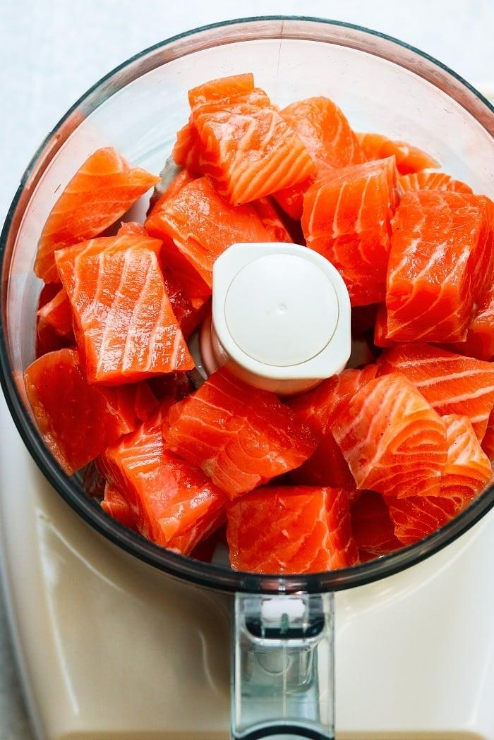 salmon chunks in food processor bowl