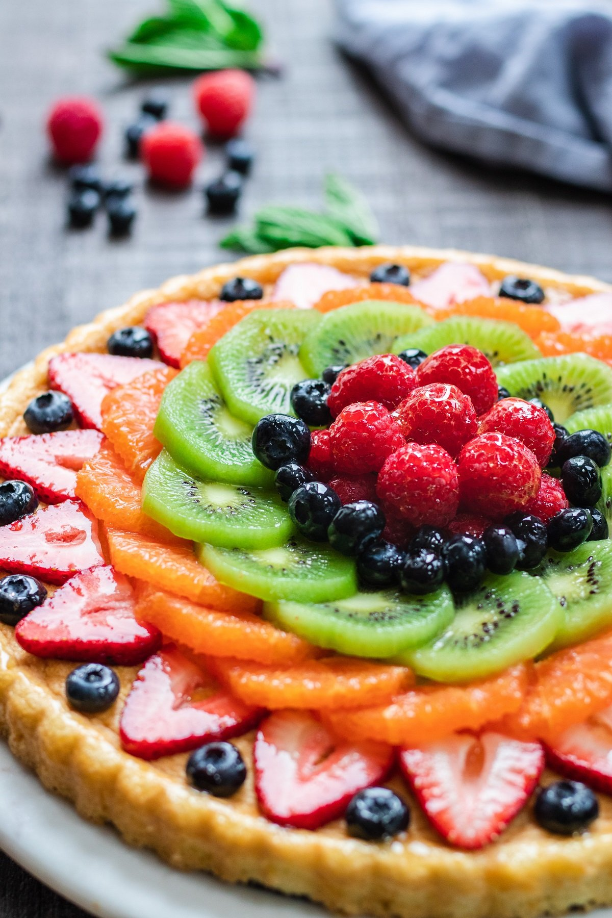 Glazed German Fresh Fruit Flan – a classic, delicious recipe showcasing beautiful fruit on light, lemon-scented sponge cake! giveitsomethyme.com