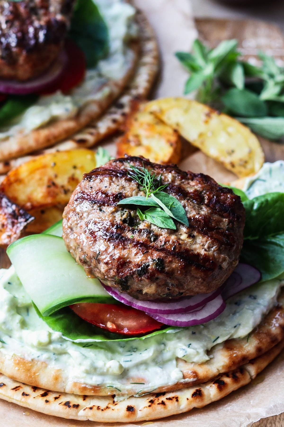 Grilled Greek lamb burgers served on pitas with tzatziki, lettuce, red onion and tomato.