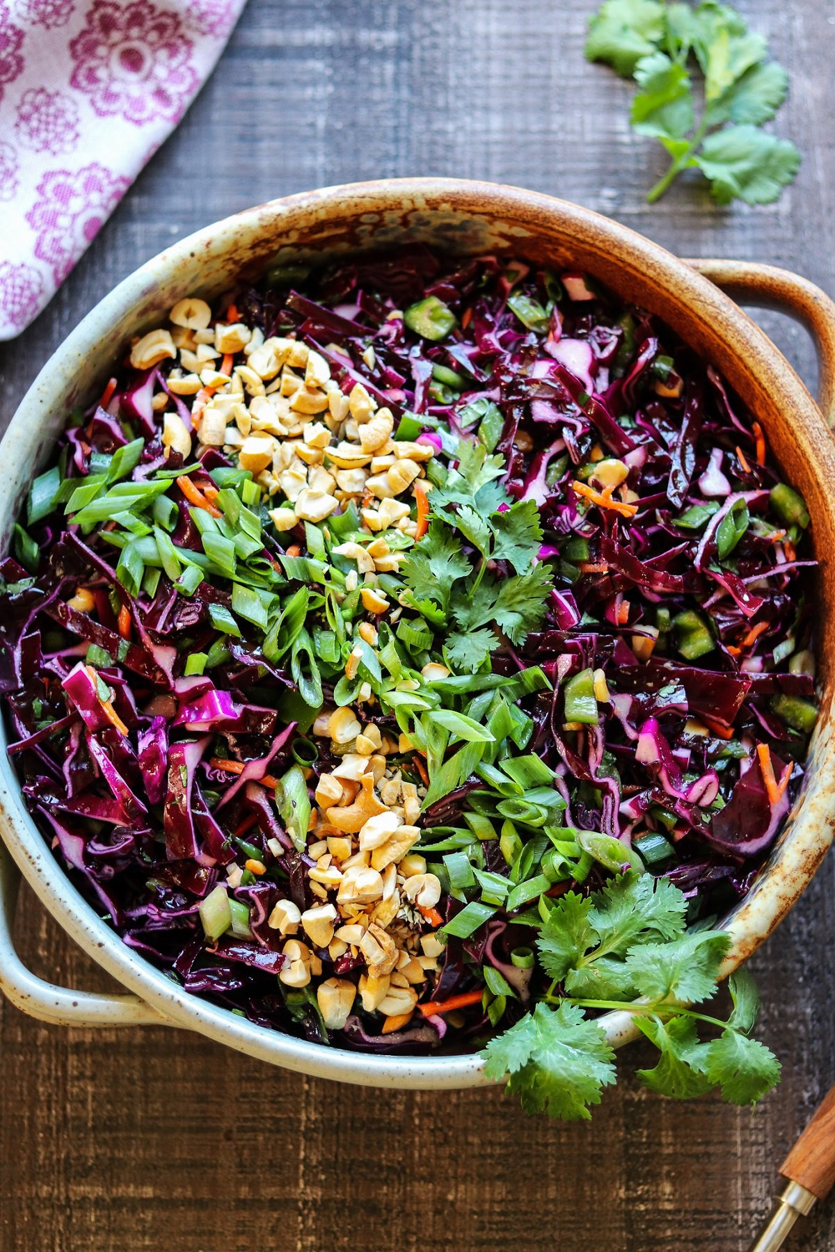 Asian slaw topped with cashews, cilantro and green onion slices.