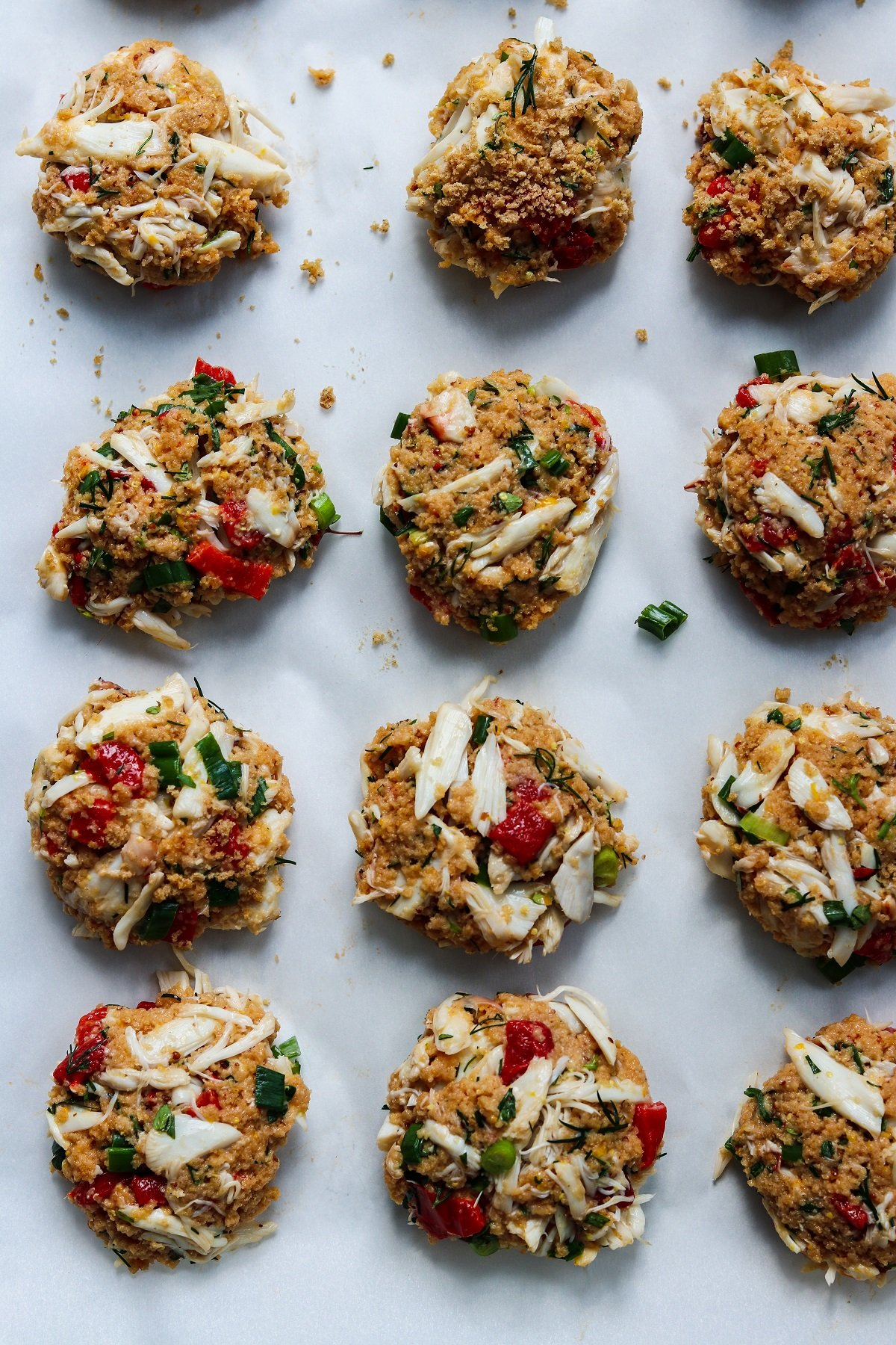 Crab cakes formed on baking sheet ready to refrigerate.