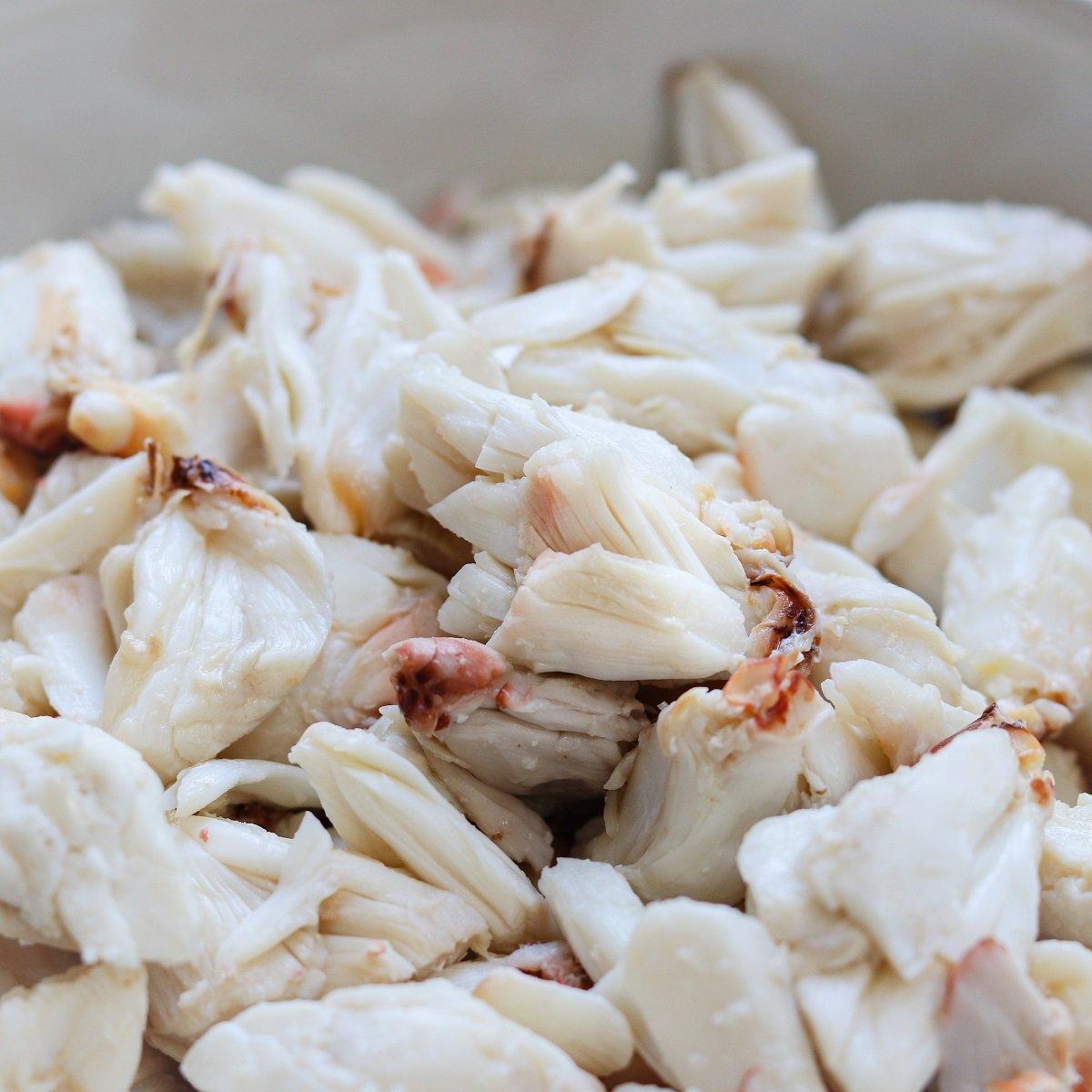 Jumbo lump crab meat in white bowl.