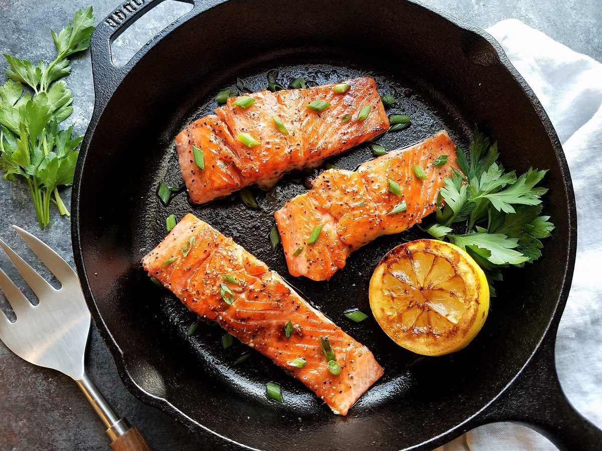 Seared salmon ready to serve from cast iron skillet.