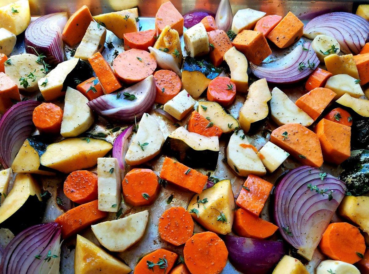 Fall veggies on sheet pan seasoned and ready to roast.