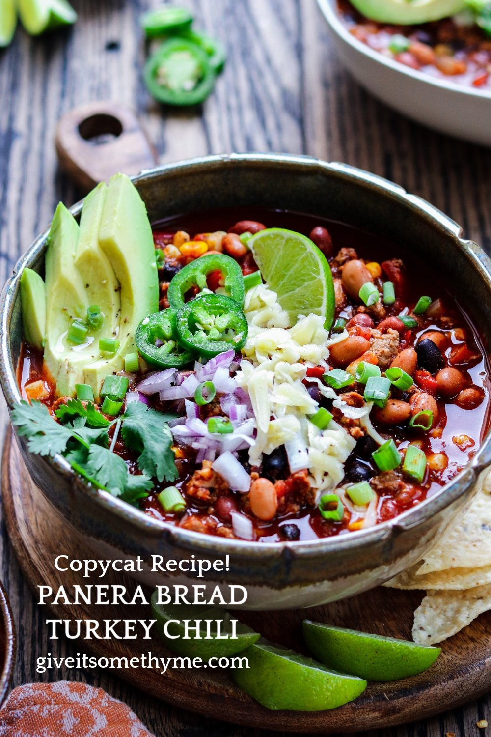 Copycat Panera Bread Turkey Chili Recipe served with lime wedges, tortilla chips and lots of cheese!